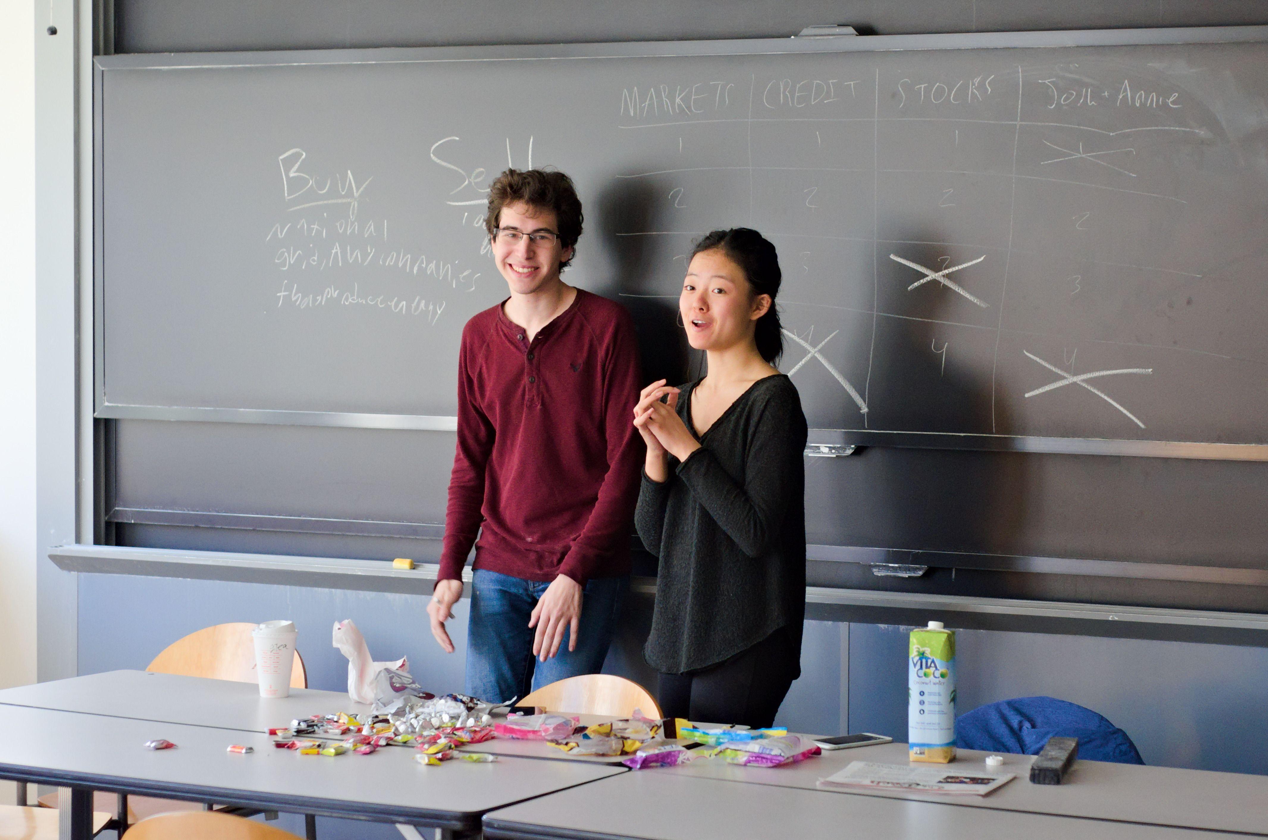 Two teachers standing in front of a chalkboard